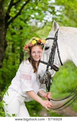 Smiling cute girl with horse in the forest poster