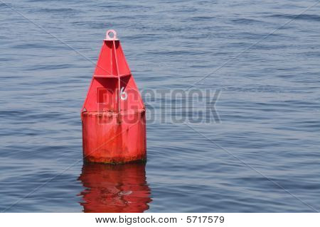 Red bouy in calm waters