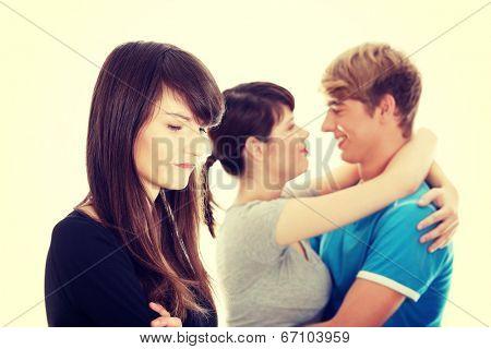 Sad brunette girl jealousy about her friend.