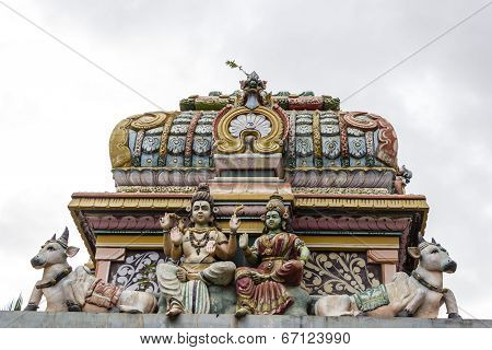 Architectural monument of Hindu God Shiva and Goddess Parvati at the entrance of old temple