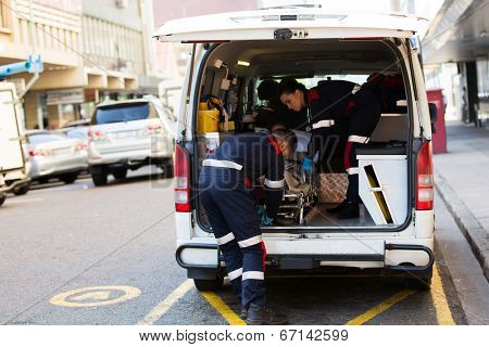 paramedics offloading patient from an ambulance