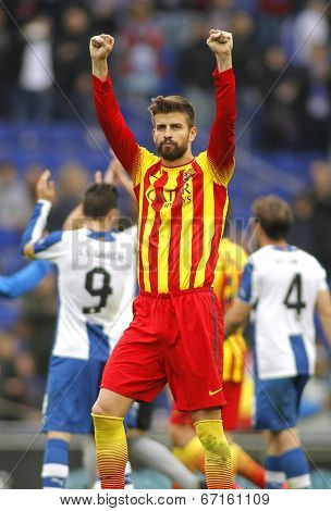 BARCELONA - MARCH, 29: Gerard Pique of FC Barcelona celebrates a goal during a Spanish League match against RCD Espanyol at the Estadi Cornella on March 29, 2014 in Barcelona, Spain