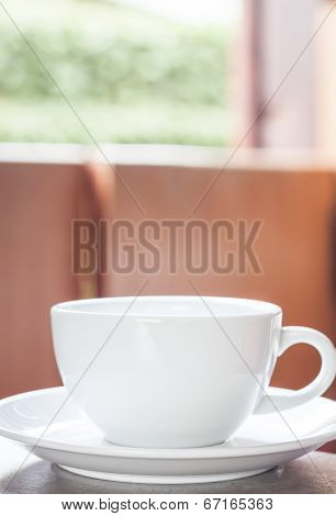 White Coffee Cup On The Table