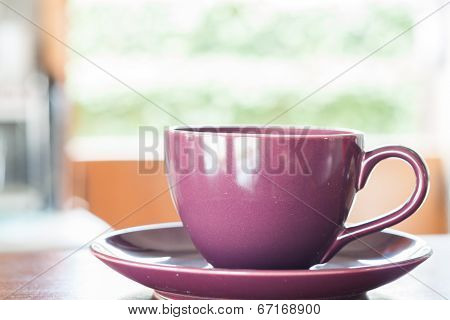 Purple Coffee Cup On Wooden Table