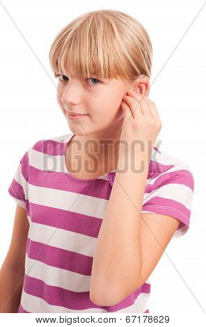 Young Girl setting her hearing aid
