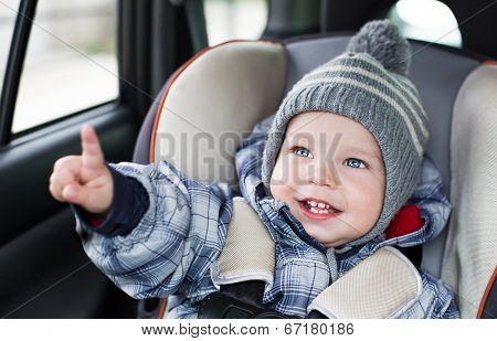 Toddler  Boy Sitting In The Car Seat