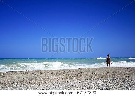 Woman In Bikini Standing On The Beach