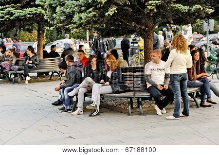 People sitting on a park bench in Bitola
