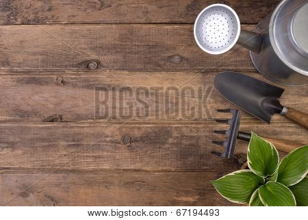 Gardening tools o wooden background with copy space