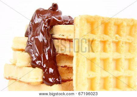 Waffles covered with chocolate on a white background ** Note: Soft Focus at 100%, best at smaller sizes