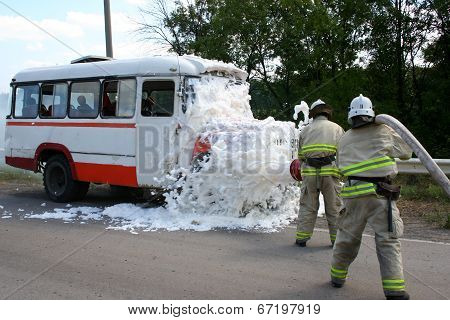 Firefighters  Extinguish A Burning Bus