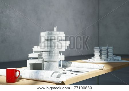 Blueprint and architectural model on desk in office of an architect (3D Rendering)
