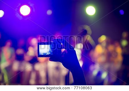 Taking picture at a music concert