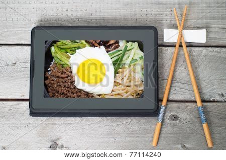 On-line And Web Asian Food Ordering Concept With Digital Table And Chopsticks