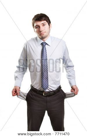 Sad And Broke Businessman With Empty Pockets