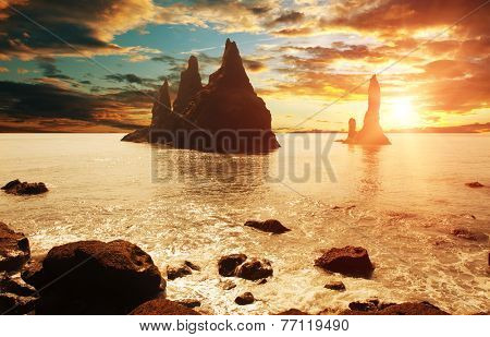 Reynisdrangar rock formations near Vik at sunset, Iceland