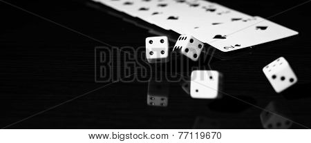 Gaming dice and a row of playing cards.