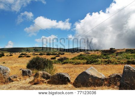 desert, large stones and clouds