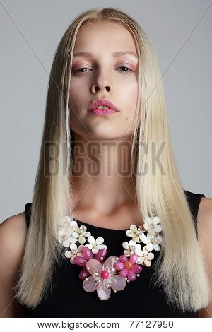 Long Hair Blonde With Vernal Garland On Her Neck