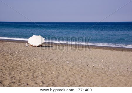 lonely umbrella on beach