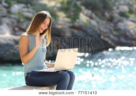 Tourist Woman On Holidays Enjoying Online With A Laptop