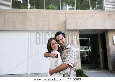 Owner Of A New Apartment: Couple Holding Keys