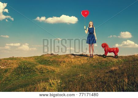 Young girl with a red ball