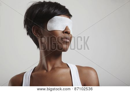 Woman With A White Cosmetic Eye Mask