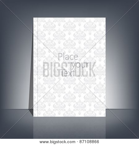 White blank stationary in the style of Baroque near the black wall with shadow. Magazine, book, flye