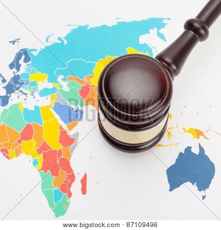 Wooden Judge's Gavel And Over World Map