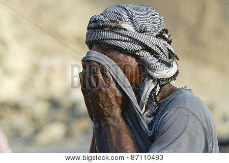 Portrait of unidentified man wearing traditional head scarf in Aden, Yemen.