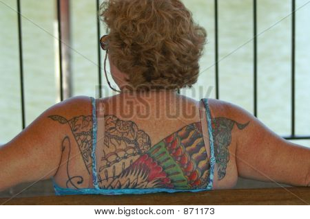 Older Woman W/Large Tattoo