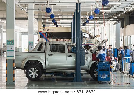 Phuket, Thailand - March 10 : Car Technician Repairing Car In Workshop Service Station In Phuket On