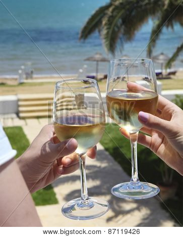 Man And Woman Clanging Wine Glasses