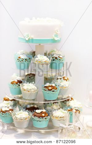 Wedding Cake And Cupcakes In Brown And Cream In Blue, White And Brown.