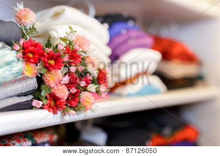 Flower Bouquet on Clothing Shelf