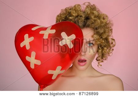 Hurt Young Woman With Ball In Shape Of Heart