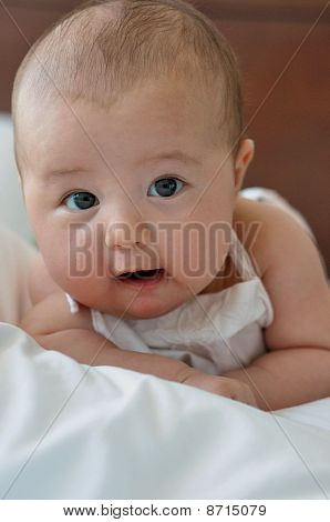 Adorable 3 months old baby girl close up portrait