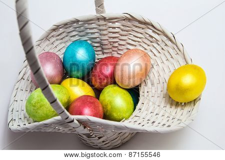 Easter Colored Eggs In A White Basket
