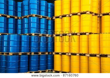 Blue and yellow oil drums in a factory