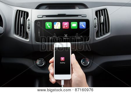 Man Connecting Phone To The Car Media System