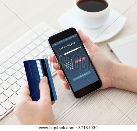Woman Holding Phone With Online Shopping And A Credit Card