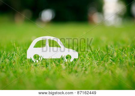 Paper Cut Of Car On Green Grass
