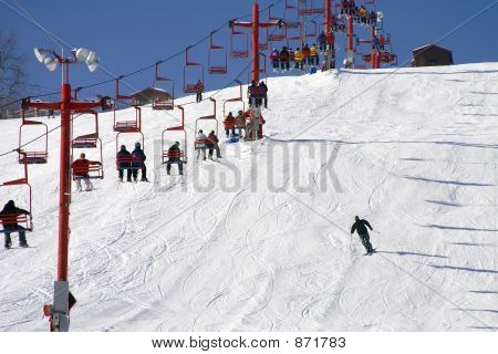 Snoboard and Skiing Lift