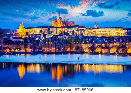Travel Prague Europe background - view of Prague Castle and St. Vitus cathedral in twilight with dramatic sky. Prague, Czech Republic
