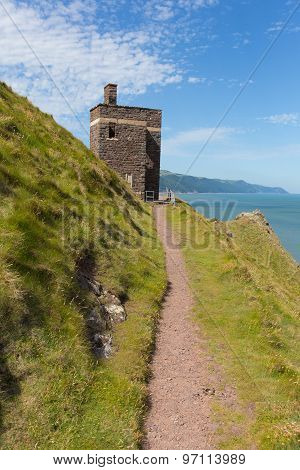South west coast path near Porlock Somerset England UK old coastguard lookout tower at Hurlstone Poi