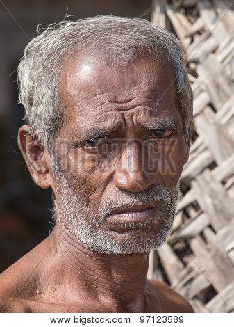 Sri Lankan beggar waits for alms on a street