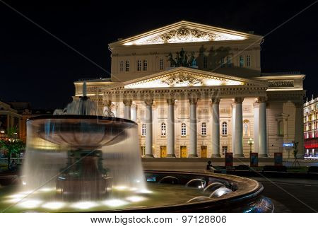 Fountain in front of Bolshoi Theater (Large, Great or Grand Theater, also spelled Bolshoy) at night time, Moscow, Russia