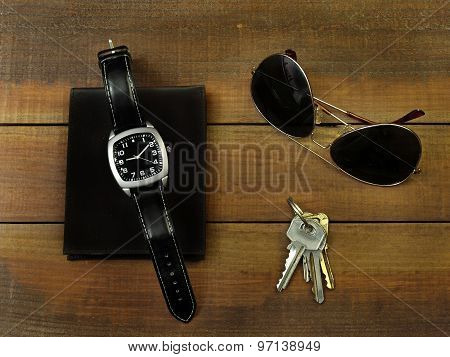 Daily use objects on a table,watch,keys,glasses