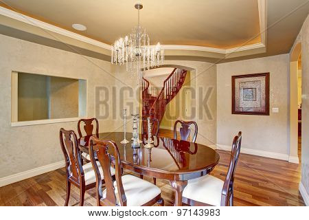 Classical Dinning Room With Beautiful Glass Chandelier.